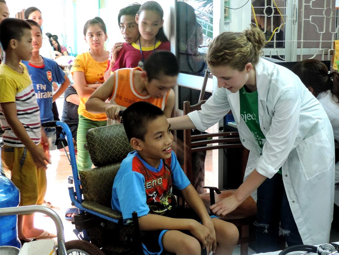 A medical volunteer in Vietnam participates in a community healthcare outreach